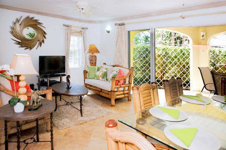 Side Of The Complex Elegantly Furnished And Accented With Pops Tropical Colour Open Plan Layout Features A Dining Area Living Room