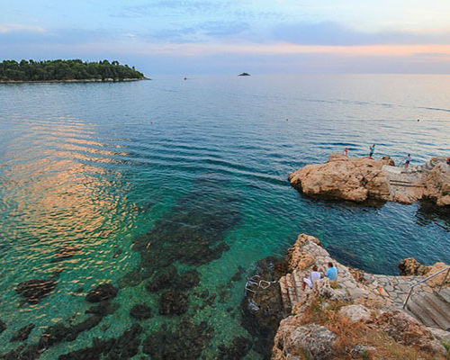 rock at rovinj at sunset