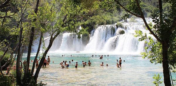 Bathing in Krka falls