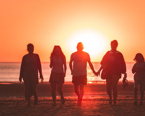 Family walking in the sunset