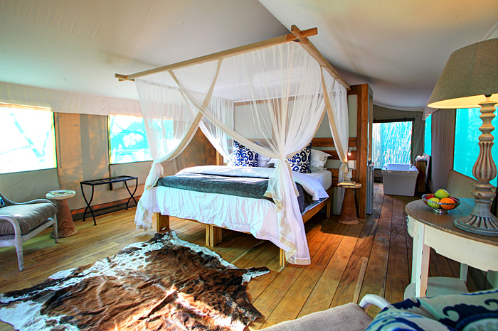 Four poster bed in a luxury safari tent in Senegal