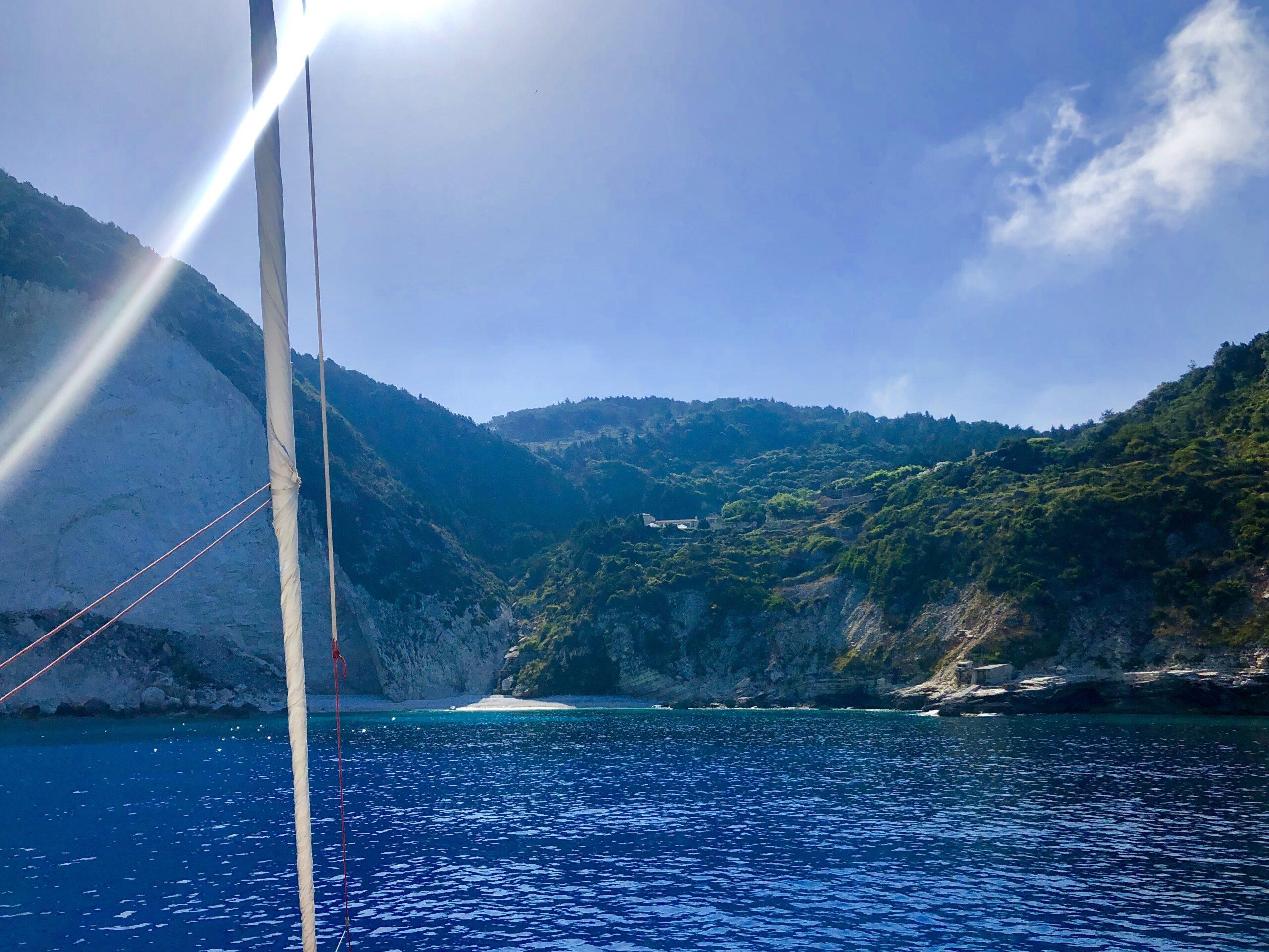 A beach seen from the boat of a catamaran